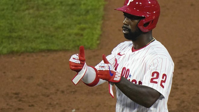 The Phillies' Andrew McCutchen gestures to the dugout after hitting a two-run single off of Orioles pitcher Alex Cobb in the third inning Tuesday night at Citizens Bank Park.