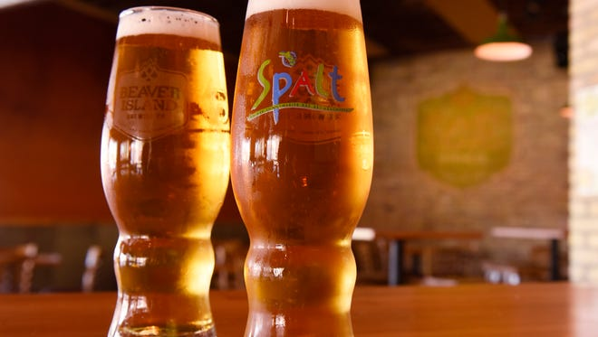 A commemorative glass is filled with Maibock at Beaver Island Brewing Co., in St. Cloud.