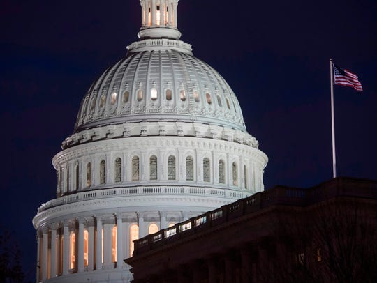 The U.S. Capitol Building is seen at dusk in Washington,