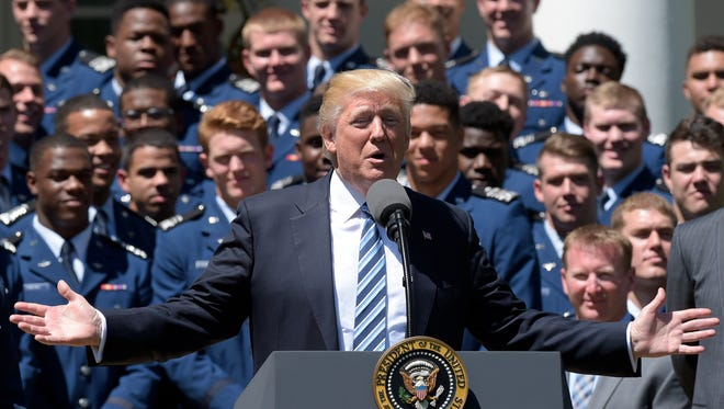 President Donald Trump speaks Tuesday in the Rose Garden of the White House, during a presentation ceremony of the Commander-in-Chief trophy to Air Force Academy football team.
