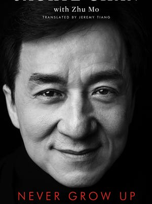 """The cover of """"Never Grow Up,"""" a memoir by Jackie Chan, which will be released in November."""