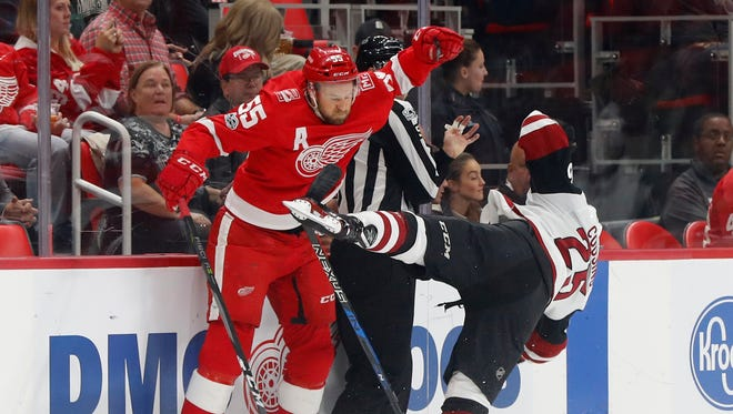Detroit Red Wings defenseman Niklas Kronwall, of Sweden, (55) checks Arizona Coyotes center Nick Cousins (25) in the first period of an NHL hockey game Tuesday, Oct. 31, 2017, in Detroit. (AP Photo/Paul Sancya)