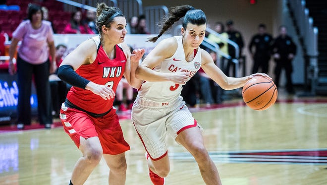 Ball State's Carmen Grande dribbles past Western Kentucky's defense during their game at Worthen Arena Thursday, Dec. 21, 2017.