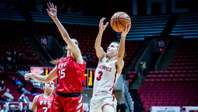Ball State's Carmen Grande shoots past Western Kentucky's defense during their game at Worthen Arena Thursday, Dec. 21, 2017.