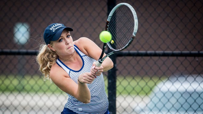 Delta's Eleah Snider hits against Yorktown's Samantha Academia during their sectional match at Delta High School Friday, May 18, 2018.
