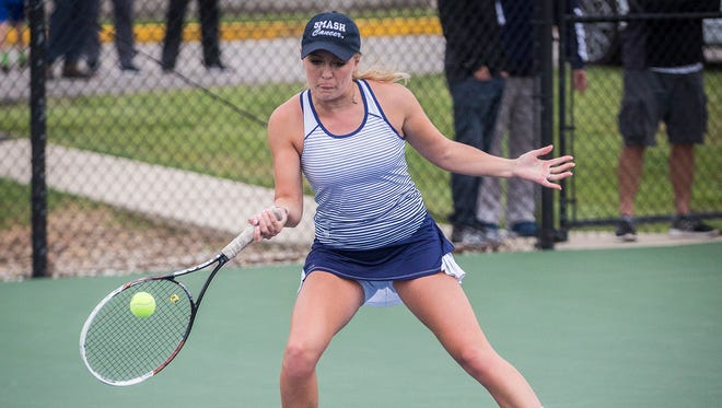 Delta's Ellie Snider, shown here in the sectional championship match last season, has been an all-state selection at No. 1 singles the last two years.