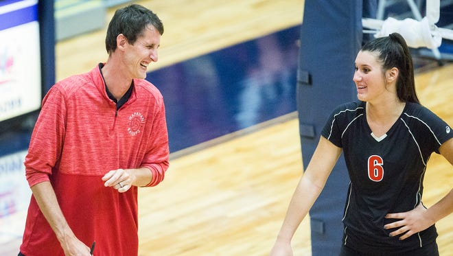 Wapahani coach Jared Richardson laughs with Estella Davis during a match at Delta High School Tuesday, Aug. 14, 2018. Davis was one four Raiders to make all-county.