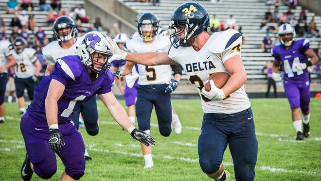 Delta's Brady Pease tries to avoid Central's Andrew Abbott at Central Friday, Aug. 17, 2018.