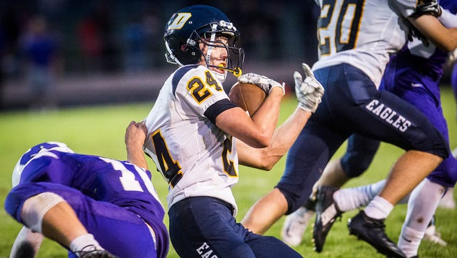 Delta's Wesley Woodin gets tackles against Central at Central Friday, Aug. 17, 2018.