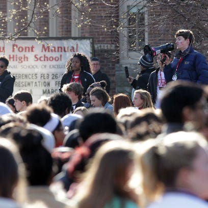 Students from Manual High School walk out of their