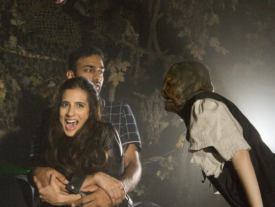 Visitors brave the frights at the 13th Floor Haunted