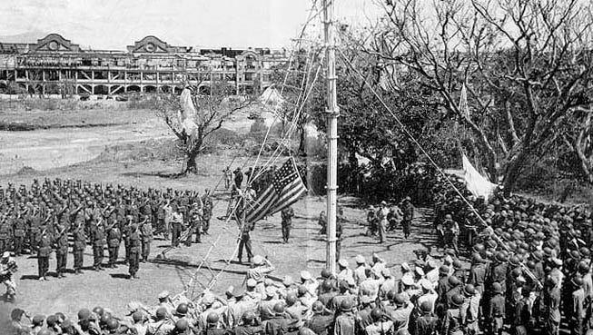 The American flag is raised on Corregidor after recapture of the island in March of 1945