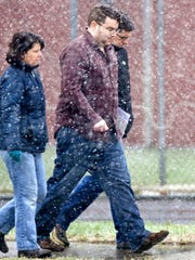 Suspended Colchester Police detective Tyler Kinney, center, leaves the Northwest State Correctional Facility in St. Albans on Nov. 17.