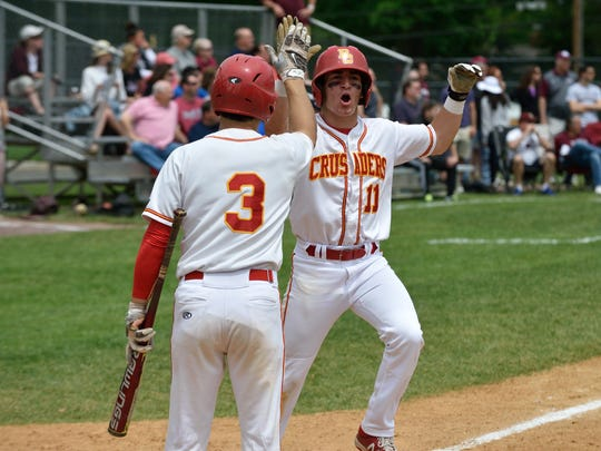 Bergen Catholic's Rob Cappadonna celebrates a run in the game against Don Bosco at the Bergen County Baseball Tournament Finals in Demarest.