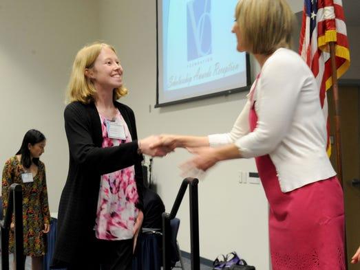 Cianna Calia shakes the hand of Darrin Peschka, news