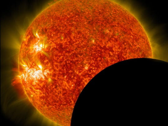 The sun with the moon partially eclipsing it, taken by the Solar Dynamics Observatory