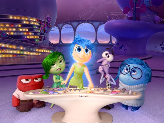 "In this image released by Disney-Pixar, characters, from left, Anger, voiced by Lewis Black, Disgust, voiced by Mindy Kaling, Joy, voiced by Amy Poehler, Fear, voiced by Bill Hader, and Sadness, voiced by Phyllis Smith appear in a scene from ""Inside Out."""