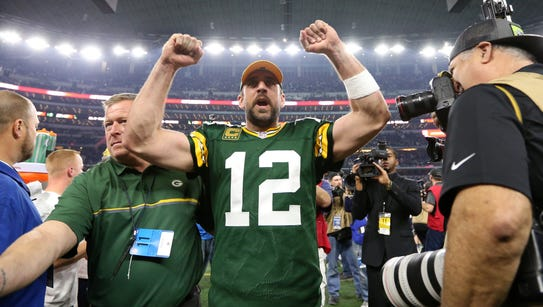 Green Bay Packers quarterback Aaron Rodgers celebrate