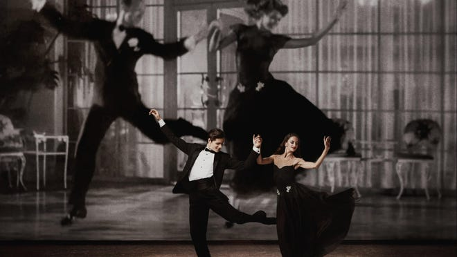 """Emily Bromberg and Jovani Furlan of Miami City Ballet dance against a backdrop of the projected images of Fred Astaire and Rita Hayworth in Jerome Robbins' """"I'm Old Fashioned."""""""