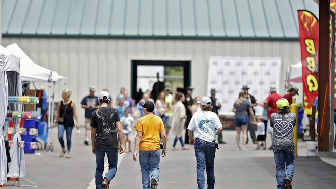 Children walk around the Pickaway County Fair in Circleville on June 22. The Pickaway County Fair was the first fair in the state to open this year.