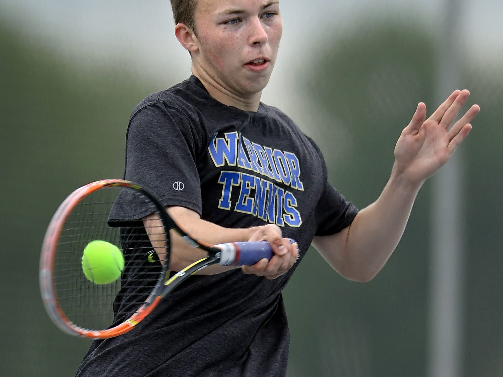Webster Schroeder's Matt Gamble hits a forehand return during the Section V New York State Qualifiers held at Webster Schroeder High School on Saturday, May 16, 2015.