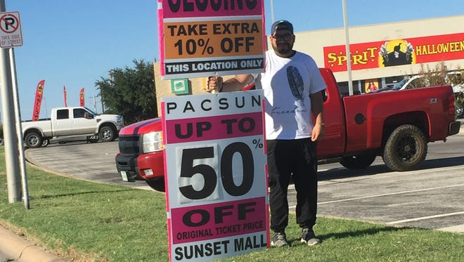 A sign holder props up a sign Friday, Oct. 13, 2017, indicating that the PacSun in Sunset Mall will be closing.