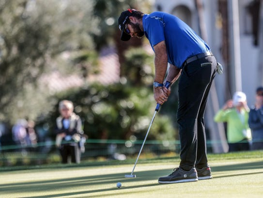 Tom Whitney putts on 9 at La Quinta Country Club during