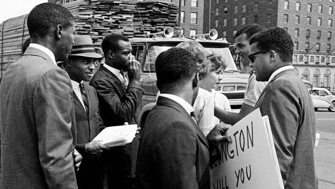 """Rev. James Lawson, right, aids a group of 18 blacks and whites picket the State Capitol Sept. 8, 1961, and tried to see Gov. Buford Ellington to seek reinstatement of 14 """"Freedom Riders"""" dismissed from Tennessee A & I State University in June."""