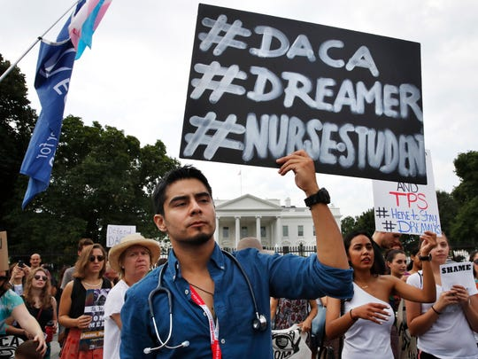 Carlos Esteban, 31, of Woodbridge, Virginia, a nursing student and recipient of Deferred Action for Childhood Arrivals, known as DACA, rallies with others in support of DACA outside of the White House, in Washington, Tuesday.
