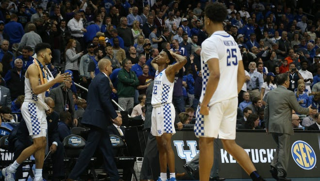 Kentucky guard Shai Gilgeous-Alexander (22) reacts after losing to Kansas State in the Sweet 16.