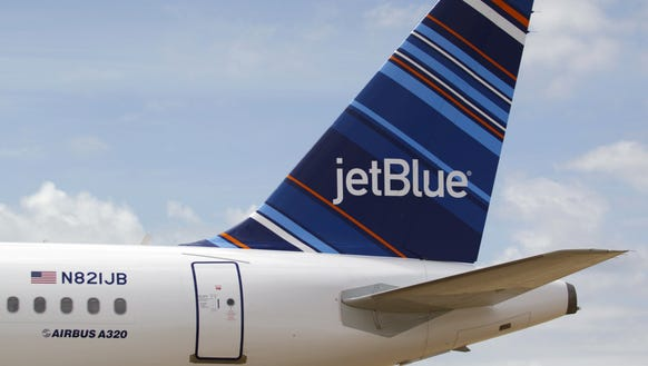 A JetBlue A320 is parked at Brookley Field near Mobile,