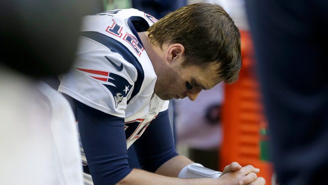 New England Patriots quarterback Tom Brady (12) sits on the bench before the NFL Super Bowl XLIX football game against the Seattle Seahawks Sunday, Feb. 1, 2015, in Glendale, Ariz.