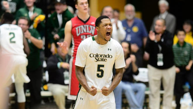 CSU's Fred Richardson reacts after a key basket by teammate J.D. Paige in the final minute of a 66-65 win Wednesday over UNLV at Moby Arena. Richardson has played a key role for the Rams in their past two games after sitting out the previous eight.