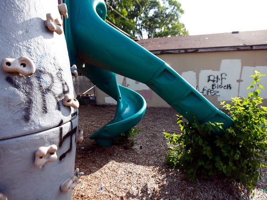 Graffiti is shown on playground equipment behind 131 Second Street and an adjacent building in Lakewood Friday morning, August 26, 2016.