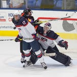 Team USA forward Josh Norris (No. 14) watches teammate Randy Hernandez hit the crossbar behind Youngstown goalie Darion Hanson Saturday night.