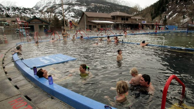 People swim in the Ouray hot springs in this 2006 file photo.