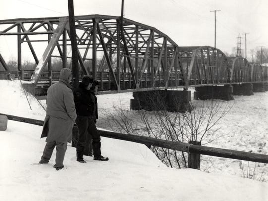 A trio of men overlook the ice-filled Muskingum River in Philo after the 1978 blizzard.