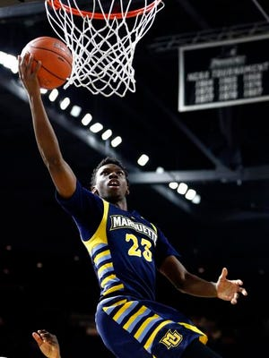 Marquette Golden Eagles guard Jajuan Johnson (23) shoots the ball against the Providence Friars during the second half at Dunkin Donuts Center on Tuesday night.