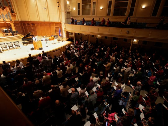 "The crowd at the 27th annual Fox Cities Dr. Martin Luther King Jr. community celebration stand and join with B. Lilly to sing ""Lift Every Voice and Sing"" Monday, Jan. 15, 2018, at Lawrence Memorial Chapel in Appleton, Wis.