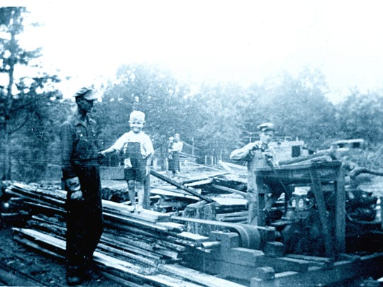 A sawmill in the Culp-McPherson area. From left, Elmer Cobb with son W.A., his wife Ruby holding Junior in the background, and on the right is Tommy Acklin