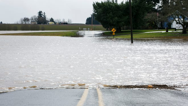 A section of road along 86th Avenue between Roanoke Drive and Waconda Road NE was flooded on Thursday, Feb. 9, 2017. A flood watch for the Willamette Valley remains in effect through Saturday morning. .