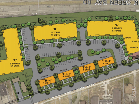 A developer is proposing to build threelarge apartment