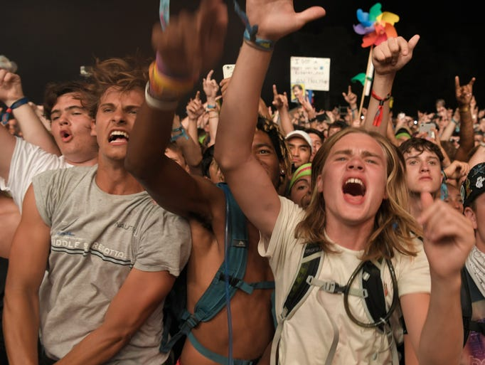 Fans cheer as Travis Scott  performs on the final night