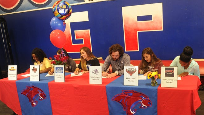 Six Cooper High athletes were part of a college signing ceremony Monday at the Cooper weight room. Pictured, left to right, are Daniece Edwards, Judith Macias, Jenna Morris, Nick Powell, Kylie Long and Taja Lawrence.