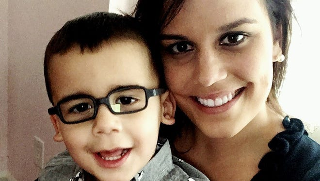 This provided photo shows Erica Hammel and her son, Wyatt. Hammel is pushing legislation to create a public registry for convicted child abusers.