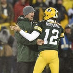 Green Bay Packers legend Brett Favre hugs quarterback Aaron Rodgers after Favre's halftime ceremony on Thanksgiving at Lambeau Field.