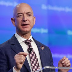 Amazon CEO Jeff Bezos' net worth tops $150B as he becomes richest person in modern history