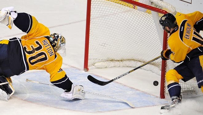 Predators goalie Carter Hutton (30) makes a backhanded save in the third period Tuesday.