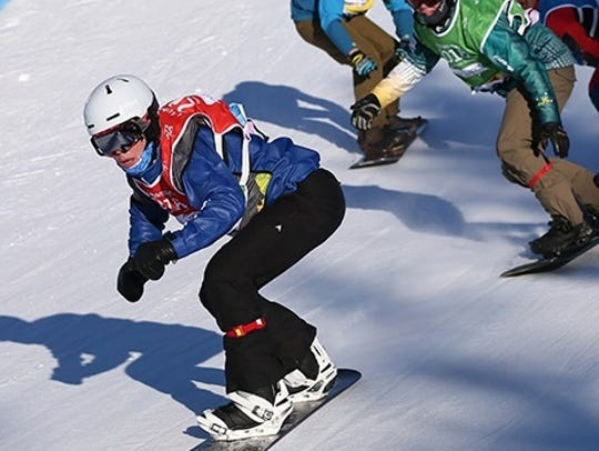 Jake Vedder USA (left) competes during the Men's Snowboard