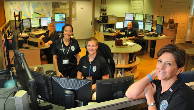 """The Melbourne Police dispatchers in the Melbourne Police Comm Center (left to right)Laura Pugesek, Tara Steele, Stacy Davenport, Howard """"Chico"""" Sanchez and acting supervisor Joannah Booth."""
